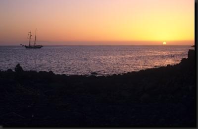 Západ slunce nad pobřežím Gomery